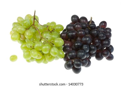 Green and blue grapes on a white background.