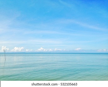 green blue sea and clear blue sky sharing the same border with copy space,  blue sea and sky background