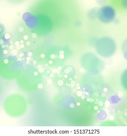 Green, blue, and white bokeh background