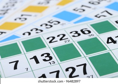 Green, blue, yellow bingo cards with focus on number thirteen