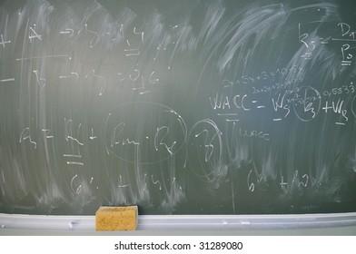 green board at university classroom with writen ecenomy and finance formulas