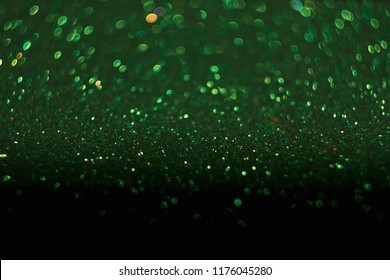 Green bokeh, abstract with defocused lights.