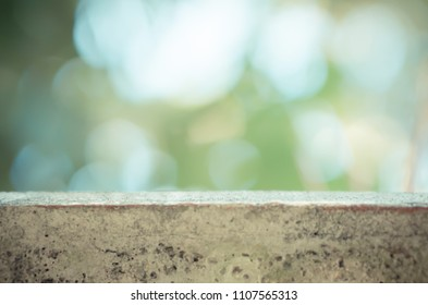 green bokeh with brown concrete table display,backdrop background