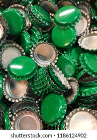 Green bottle crown caps
