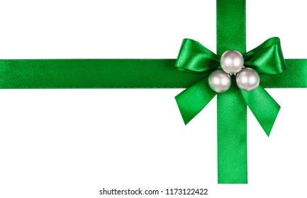 Green bow, ribbon with christmas balls. Isolated on white background.
