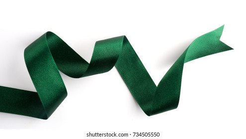 Green bow ribbon satin texture isolated on white background