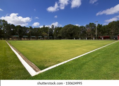 Green bowls or lawn bowls player ground which is natural grass or artificial turf surrounded with spot light, scorecard etc.