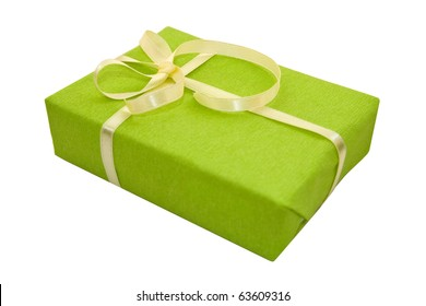 A green box tied with a yellow satin ribbon bow. A gift for Christmas, Birthday, Wedding, or Valentine's day. Isolated on white with clipping path.