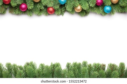 green branches of a fir tree with christmas balls isolated on white background, christmas frame with copy space