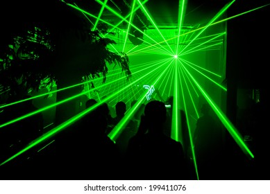 Green bright lasers at nightclub party rave