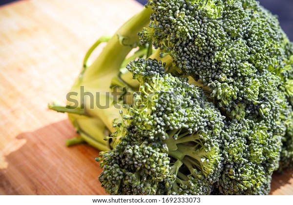 Green broccoli on a wooden board