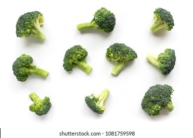 Green broccoli pattern food. Isolated vegetable on white background. Top view.