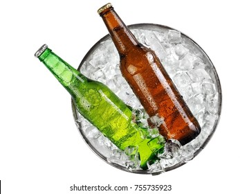 Green and brown beer bottles in a bucket with ice, top view