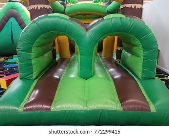 green and brown inflatable bounce house
