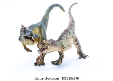 Green and brown Long Running Carnotaurus fighting an Allosaurus - front view