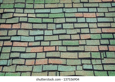 Green and brown old-fashioned shingled roofing