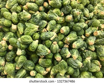 Green Brussels sprout vegetables fill the image