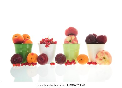 Green bucket full with fresh fruit isolated over white background