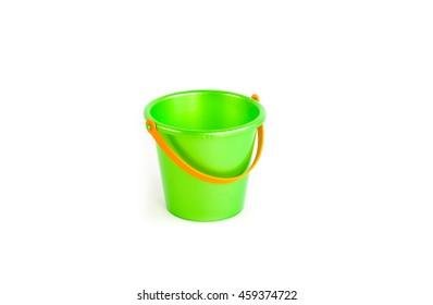 green bucket. a toy