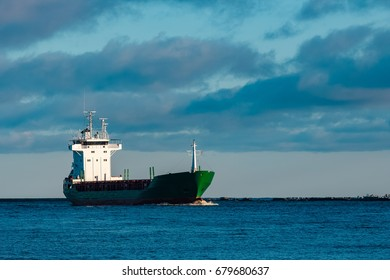 Green bulk carrier sailing from the Baltic sea