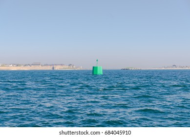 Green buoy in the sea in Brittany, France