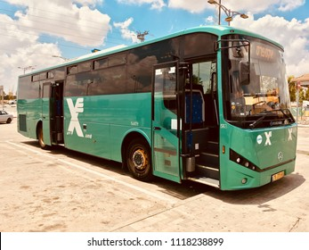Green bus Egged open doors in parking Israel. Israel, Negev, June 2018