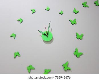 green butterfly clock