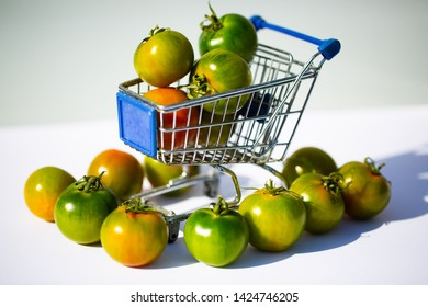 green camone tomatoes in shopping cart