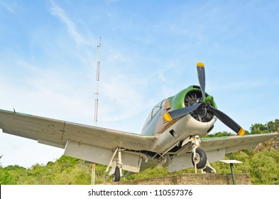 Green camouflage old fighter plane with propeller, Metal airplane for military purpose, Combat aircraft in World War 2 history in aviation museum outdoor on sky background, Thailand