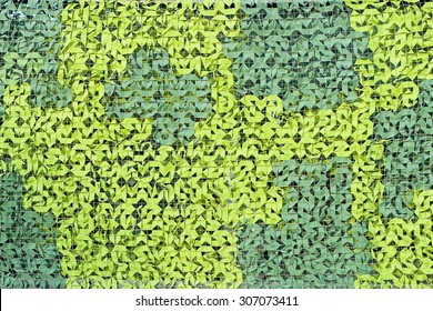 Green camouflage pattern. Camo netting background