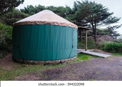 Green camping (or glamping) yurt on the Oregon Coast at a beach campground.
