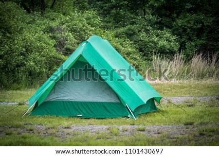Green c&ing tent pitched and ready in a grassy wooded c&ground. & Green Camping Tent Pitched Ready Grassy Stock Photo (Edit Now ...