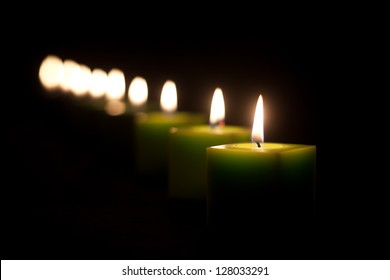 green candles in the dark