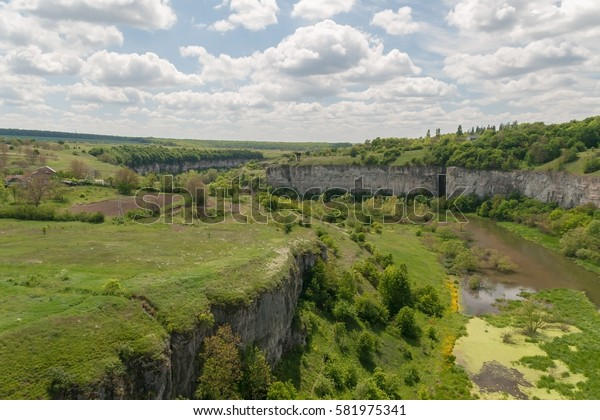 green canyon in Kamenetz-Podolsk, Ukraine and the sky with clouds.