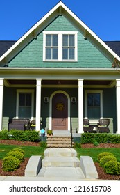Green Cape Cod American Home with Large Front Porch