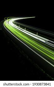 green car lights at night. long exposure