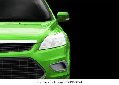 Green car on black background