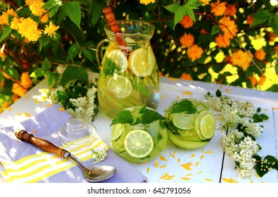 green carbonated lemonade with lime and cucumber, ice