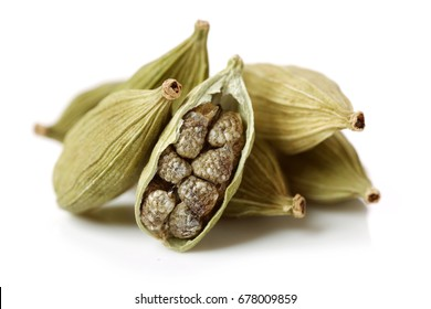 Green cardamom pods on white background