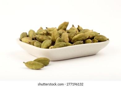 Green Cardamom pods in plate