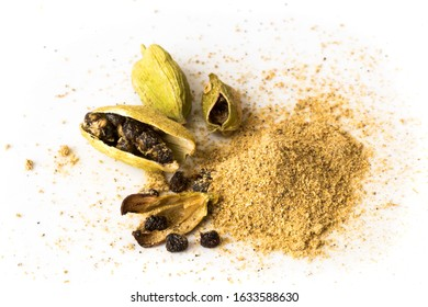 Green cardamom pods, seeds and ground spice. Isolated on white background