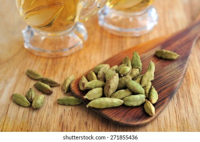 Green cardamom with green tea in glasses cup