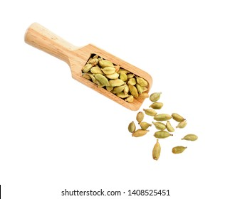green cardamon isolated in wood scoop on white background