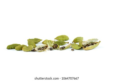 Green cardamon seeds on a white background