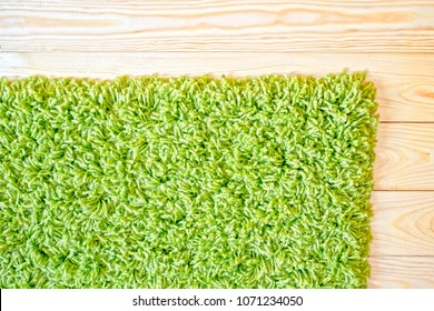 green carpet on the wooden floor