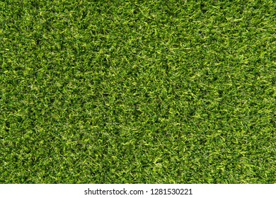 Green carpet texture background. Surface green microfiber plastic carpet mat background pattern design. Green grass artificial carpet background golf field courses. Green texture abstract background