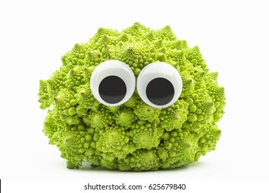 green cauliflower with googly eyes on white background