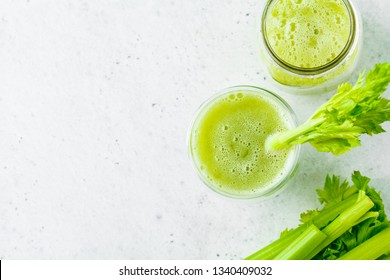 Green celery juice in a glass, top view, copy space.