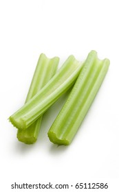 green celery sticks on white background