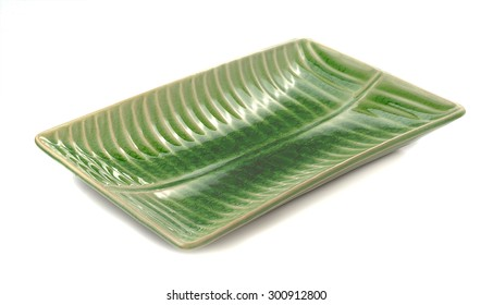 Green ceramic plate on a white background .